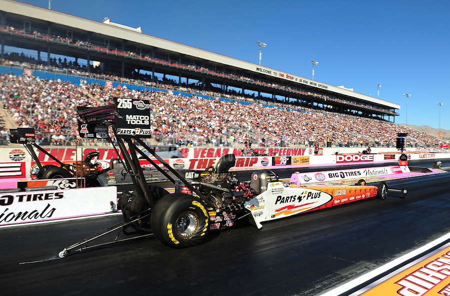 Oct. 30, 2011; Las Vegas, NV, USA: NHRA top fuel dragster driver Clay Millican (near lane) races alongside Bob Vandergriff Jr during the Big O Tires Nationals at The Strip at Las Vegas Motor Speedway. Mandatory Credit: Mark J. Rebilas-