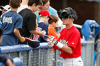 July 19, 2009:  Shortstop Ryan Jackson of the Batavia Muckdogs signs autographs before a game at Dwyer Stadium in Batavia, NY.  The Muckdogs are the NY-Penn League Short-Season Class-A affiliate of the St. Louis Cardinals.  Photo By Mike Janes/Four Seam Images