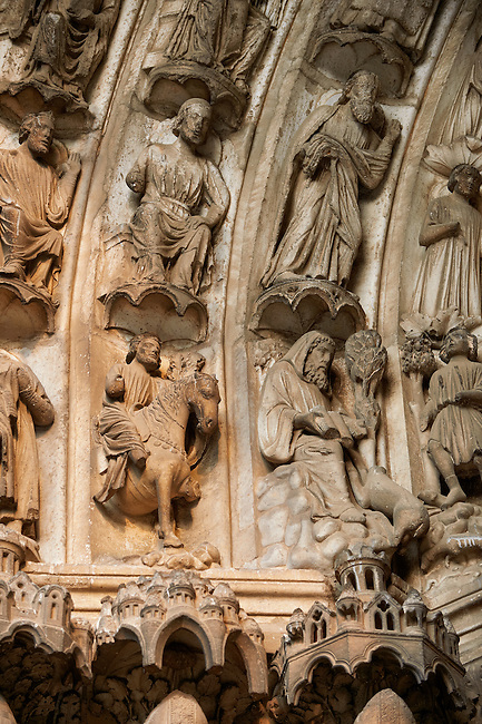 .South Porch, Right Portal archivolts c. 1145. Cathedral of Chartres, France. Gothic statues of the archivolts on the lower register of archivolts are miracles of Gilles, including the Mass of St. Gilles (right). The other archivolts show various Confessors.. A UNESCO World Heritage Site. .