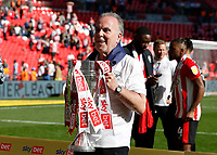 29th May 2021; Wembley Stadium, London, England; English Football League Championship Football, Playoff Final, Brentford FC versus Swansea City; Brenford Player Welfare Manager and PA Announcer nicknamed Mr Brentford Peter Gilham lifts the Sky Bet EFL Championship Plays-off Trophy and their 2-0 win and promotion to the Premier League