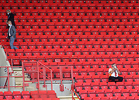 A steward adjusts his mask and West Ham Manager, David Moyes and his Assistant, Alan Irvine, leave the ground via an exit during Charlton Athletic vs Wigan Athletic, Sky Bet EFL Championship Football at The Valley on 18th July 2020