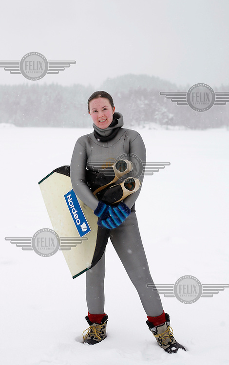 Elisabeth Krisoffersen from Norway with monofin. Freediving competition Oslo Ice Challenge at freshwater lake Lutvann outside the Norwegian capital Oslo. Atheletes, including current and former world champions, entered a hole in the ice to compete. The participants reached depths down to 52 meters below the surface.