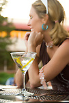 Woman sitting with a martini in front of her