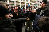 WASHINGTON DC - JANUARY 20: Police, anti-Bush and pro-Bush demonstrators clash near Penn Ave during the inaugural  parade on January 20, 2005 in Washington DC. (photo by Anthony Suau)