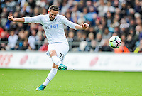 Swansea take on Liverpool at The Liberty Stadium on October 1, 2016 in Swansea, Wales. Gylfi Sigurdsson takes a free kick.