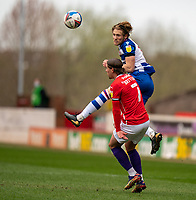 2nd April 2021, Oakwell Stadium, Barnsley, Yorkshire, England; English Football League Championship Football, Barnsley FC versus Reading; Lewis Gibson of Reading flicks a header beyond Callum Brittain of Barnsley