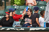 Rochester Red Wings fan applies ice to her head after getting hit by a broken bat during a game against the Pawtucket Red Sox on July 1, 2015 at Frontier Field in Rochester, New York.  Rochester defeated Pawtucket 8-4.  (Mike Janes/Four Seam Images)