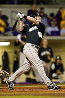Charlie Morgan #26 of the Wake Forest Demon Deacons follows through on his swing against the LSU Tigers at Alex Box Stadium on February 18, 2011 in Baton Rouge, Louisiana.  The Tigers defeated the Demon Deacons 15-4.  Photo by Brian Westerholt / Four Seam Images