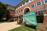 A sign outside the Becky Paneitz Student Center on Tuesday Sept. 7 2021 advertises enrollment at Northwest Arkansas Community College. Go to nwaonline.com/210908Daily/ to see more photos.<br />(NWA Democrat-Gazette/Flip Putthoff)