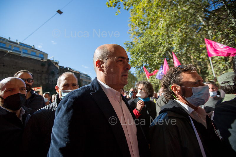"""Nicola Zingaretti (President of the Lazio Region, and former Secretary of the Democratic Party PD).<br /> <br /> Rome, Italy. 10th October, 2021. Today, thousands of people gathered outside the CGIL (CGIL Confederazione Generale Italiana del Lavoro, Italian General Confederation of Labour, Italian biggest Trade Union) HQ in Corso d'Italia in Rome to attend the Trade Union emergency General Assembly called after the vile attack perpetrated yesterday against the CGIL HQ by the fascist organization forza nuova (for a previous demo: 2.), members of no vax, no pass, no green pass, football supporters, conspiracy theorists, far-right extremists, Covid-19 deniers (negazionisti). The General Secretary of the CGIL, Maurizio Landini, in his today speech stated that what happened yesterday was a """"fascist and squad action"""" against the Workers, the founding values of the Italian Democratic Republic, the principles enshrined in the Constitution born of anti-fascism, the Resistance and the Liberation Struggle. He added that the fascist organizations (Illegal in Italy) need to be immediately dismatled, that this kind of despicable actions against Democracy cannot be tolerated, calling for a national Antifascists demonstration on the 16th October 2021 in Rome.<br /> <br /> Footnotes & Links:<br /> 1. http://cgil.it/ & https://bit.ly/2E1Al5a (Wikipedia)<br /> 2. 24.07.21 - No Green Pass Demo - Far-right, NoGreenPass, NoVax, Covid19 Deniers, Conspiracy Theorists https://lucaneve.photoshelter.com/gallery/24-07-21-No-Green-Pass-Demo-Far-right-NoGreenPass-NoVax-Covid19-Deniers-Conspiracy-Theorists/G0000m5VttrwCq6A/C0000GPpTqAGd2Gg"""