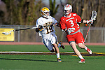 Baltimore, MD - March 3: Long stick midfielder Nathan Klein #19 of the UMBC Retrievers  defends Attackmen Sam Snow #3 of the Fairfield Stags during the Fairfield v UMBC mens lacrosse game at UMBC Stadium on March 3, 2012 in Baltimore, MD.