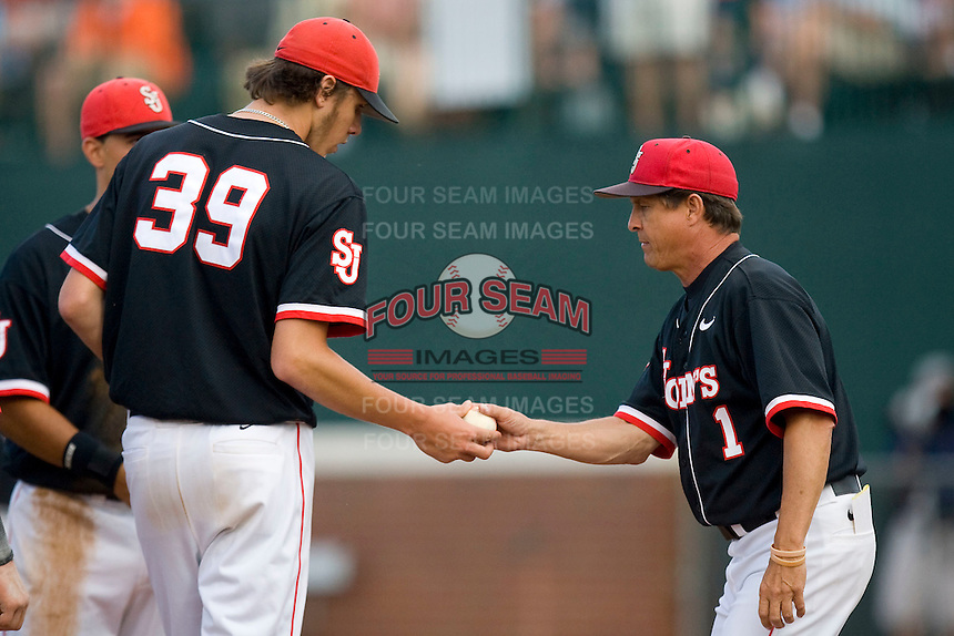 St. John's Red Storm head coach Ed Blankmeyer #1 takes the ball from starting pitcher Kyle Hansen #39 in the championship game of the Charlottesville Regional at Davenport Field on June 5, 2010, in Charlottesville, Virginia.  The Cavaliers defeated the Red Storm 5-3.  Photo by Brian Westerholt / Four Seam Images