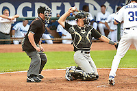 Zach Fisher (13) of the Great Falls Voyagers behind the plate with home plate umpire Jordan Johnson during the game against the Ogden Raptors in Pioneer League action at Lindquist Field on July 18, 2014 in Ogden, Utah.  (Stephen Smith/Four Seam Images)