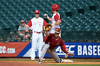 Josh McLain (15) of the North Carolina State Wolfpack beats the throw to Mitch Bigras (4) of the Boston College Eagles in Game Two of the 2017 ACC Baseball Championship at Louisville Slugger Field on May 23, 2017 in Louisville, Kentucky. The Wolfpack defeated the Eagles 6-1. (Brian Westerholt/Four Seam Images)