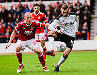 Derby County's forward Andi Weimann (19) gets the ball in front of Nottingham Forest's midfielder Ben Watson (32) during the Sky Bet Championship match between Nottingham Forest and Derby County at the City Ground, Nottingham, England on 10 March 2018. Photo by Stephen Buckley / PRiME Media Images.