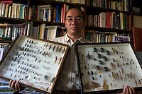 Professor Nonaka Kenichi of Tokyo's Rikkyo University holds a selection of insects  all of which are edible, Tokyo, Japan.
