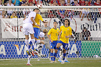 Omar Gonzalez (5) of the United States goes up for a header. The men's national team of Brazil (BRA) defeated the United States (USA) 2-0 during an international friendly at the New Meadowlands Stadium in East Rutherford, NJ, on August 10, 2010.