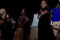 Boys and girls sing and dance at NoahÕs Ark Shelter. The shelter is one of the few places children, known as Night Commuters, can find protection every  night to avoid being abducted by the Lords Resistance Army (LRA) in Northern Uganda. The LRA is primarily made up of abducted youth. Night Commuters find much more than safety in the compounds, they also find friendships, activity and fellowship. Tens of thousands of children, on average, make this exodus every evening. The war in Northern Uganda has been transpiring for two decades. Gulu, Gulu District, Uganda, Africa. December 2005 © Stephen Blake Farrington