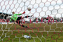 Airdrie's Bryan Prunty  scores their second goal from the spot.