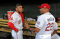 Hitting coach Nelson Paulino (22) of the Greenville Drive, right talks with second baseman Yoan Moncada (24) in a game against the Lexington Legends on Tuesday, May 19, 2015, at Fluor Field at the West End in Greenville, South Carolina. (Tom Priddy/Four Seam Images)