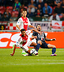 Nederland, Amsterdam, 15 augustus 2015<br /> Eredivisie<br /> Seizoen 2015-2016<br /> Ajax-Willem ll (3-0)<br /> Jairo Riedewald van Ajax en Bruno Andrade van Willem II strijden om de bal