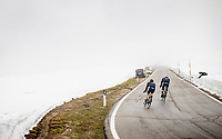 Filippo Ganna (ITA/INEOS Grenadiers) & Salvatore Puccio (ITA/INEOS Grenadiers) coming over the Passo Giau<br /> <br /> due to the bad weather conditions the stage was shortened (on the raceday) to 153km and the Passo Giau became this years Cima Coppi (highest point of the Giro).<br /> <br /> 104th Giro d'Italia 2021 (2.UWT)<br /> Stage 16 from Sacile to Cortina d'Ampezzo (shortened from 212km to 153km)<br /> <br /> ©kramon