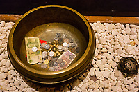 Nanjing, Jiangsu, China.  Donations Left in the Usnisa Hall, Usnisa Palace, Niushou Mountain.
