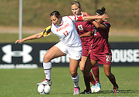 COLLEGE PARK, MD - OCTOBER 21, 2012:  Gabby Galanti (17) of the University of Maryland keeps the ball away from Kristin Grubka (13) and Ines Jaurena (2) of Florida State during an ACC women's match at Ludwig Field in College Park, MD. on October 21. Florida won 1-0.
