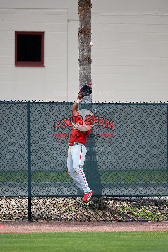 Philadelphia Phillies left fielder Adron Chambers makes a leaping catch at the wall for the out on a long fly ball by Atlanta Braves Jose Bautista (1) in the top of the third inning during a Minor League Extended Spring Training game on April 20, 2018 at Carpenter Complex in Clearwater, Florida.  (Mike Janes/Four Seam Images)