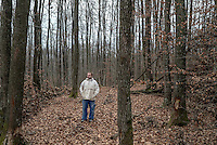 Zijad Bacic photographed in woodland near his house by which the 15 year old Zijad escaped a massacre by Serbian death squads on the 25 July 1992 in which his mother, brother and sister were killed.