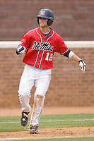 Tanner Mathis #12 of the Ole Miss Rebels takes his lead off of third base against the St. John's Red Storm at the Charlottesville Regional of the 2010 College World Series at Davenport Field on June 6, 2010, in Charlottesville, Virginia.  The Red Storm defeated the Rebels 20-16.  Photo by Brian Westerholt / Four Seam Images