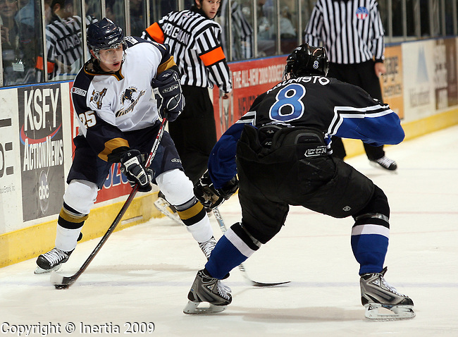 SIOUX FALLS, SD - APRIL 3:  David Eddy #25 of the Sioux Falls Stampede prepares to get the puck past Kory Kaunisto #8 of the Lincoln Stars in the second period of the Stampede regular season finale Friday night at the Sioux Falls Arena. (Photo by Dave Eggen/Inertia)