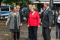 """Veranstaltung """"50 Jahre Entwicklungshelfer-Gesetz – 'Die Welt im Gepaeck'"""" am Freitag den 12. Juli 2019 in der Berliner St. Elisabethkirche.<br /> Als Gast war die Bundeskanzlerin Angela Merkel geladen.<br /> Den Ehrentag fuer zurueckgekehrte Entwicklungshilfe-Fachkraefte veranstalten die Gemeinsame Konferenz Kirche und Entwicklung (GKKE) und die Arbeitsgemeinschaft der Entwicklungsdienste (AGdD).<br /> Im Bild vlnr: Judith Ohene AGdD; Cornelia Fuellkrug-Weitzel, Praesidentin Brot fuer die Welt; Praelat Karl Juesten; Bundeskanzlerin Angela Merkel; Praelat Martin Dutzmann, GKKE.<br /> 12.7.2019, Berlin<br /> Copyright: Christian-Ditsch.de<br /> [Inhaltsveraendernde Manipulation des Fotos nur nach ausdruecklicher Genehmigung des Fotografen. Vereinbarungen ueber Abtretung von Persoenlichkeitsrechten/Model Release der abgebildeten Person/Personen liegen nicht vor. NO MODEL RELEASE! Nur fuer Redaktionelle Zwecke. Don't publish without copyright Christian-Ditsch.de, Veroeffentlichung nur mit Fotografennennung, sowie gegen Honorar, MwSt. und Beleg. Konto: I N G - D i B a, IBAN DE58500105175400192269, BIC INGDDEFFXXX, Kontakt: post@christian-ditsch.de<br /> Bei der Bearbeitung der Dateiinformationen darf die Urheberkennzeichnung in den EXIF- und  IPTC-Daten nicht entfernt werden, diese sind in digitalen Medien nach §95c UrhG rechtlich geschuetzt. Der Urhebervermerk wird gemaess §13 UrhG verlangt.]"""