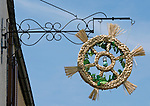 Austria, Lower Austria, UNESCO World Heritage Wachau, Duernstein: wreath of straw, sign that the wine growers have opened their Heurige pub