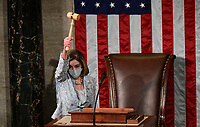 Speaker of the United States House of Representatives Nancy Pelosi (Democrat of California) wields the Speaker's gavel after being re-elected as Speaker and preparing to swear in members of the 117th House of Representatives in Washington, U.S., January 3, 2021.  <br /> Credit: Erin Scott / Pool via CNP /MediaPunch<br /> CAP/MPI/RS<br /> ©RS/MPI/Capital Pictures
