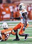 Oklahoma State Cowboys wide receiver Justin Blackmon (81) and Texas Longhorns cornerback Curtis Brown (3)) in action during the game between the Oklahoma State Cowboys and the University of Texas in Austin Texas Longhorns at the Daryl K. Royal- Texas Memorial Stadium in Austin, Texas. The Oklahoma State Cowboys defeated the Texas Longhorns 33 to 16.