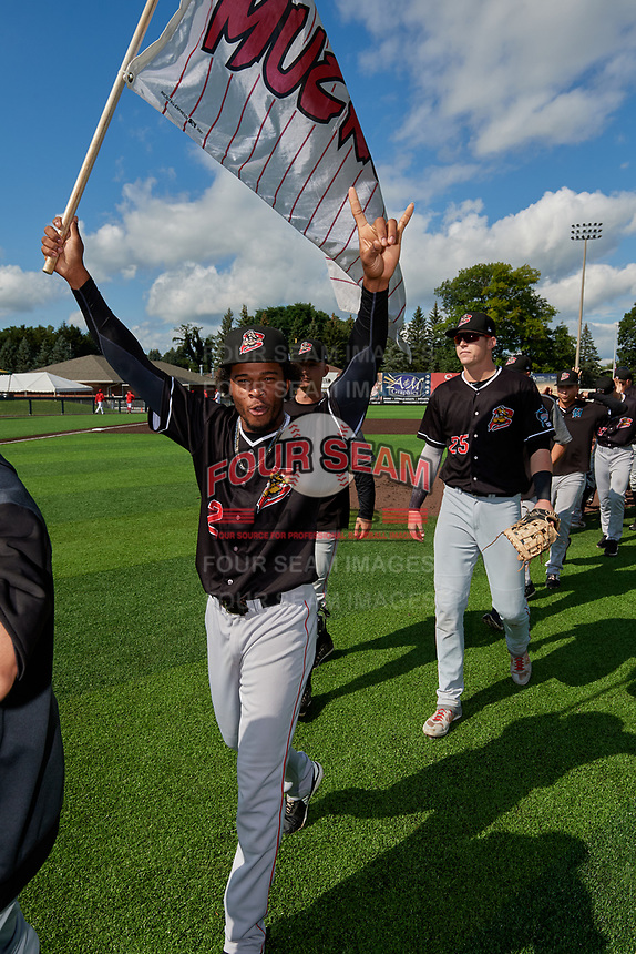 Batavia Muckdogs Ronal Reynoso (2) and Sean Reynolds (25) after clinching the Pinckney Division Title during a NY-Penn League game against the Auburn Doubledays on September 2, 2019 at Falcon Park in Auburn, New York.  Batavia defeated Auburn 7-0 to clinch the Pinckney Division Title.  (Mike Janes/Four Seam Images)