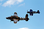B-25 bomber and Corsair flying together, Owls Head Transportation Museum, Owls Head, Maine, USA