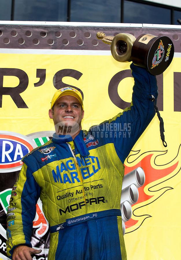 Jun. 2, 2013; Englishtown, NJ, USA: NHRA funny car driver Matt Hagan celebrates after winning the Summer Nationals at Raceway Park. Mandatory Credit: Mark J. Rebilas-