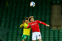 2nd January 2021; Carrow Road, Norwich, Norfolk, England, English Football League Championship Football, Norwich versus Barnsley; Callum Styles of Barnsley tussles for a header with Max Aaron of Norwich City