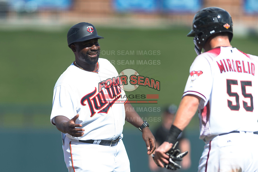 Salt River Rafters manager Tommy Watkins (8), of the Minnesota Twins organization, congratulates Dom Miroglio (55), of the Arizona Diamondbacks organization, during an Arizona Fall League game against the Surprise Saguaros at Salt River Fields at Talking Stick on October 23, 2018 in Scottsdale, Arizona. Salt River defeated Surprise 7-5 . (Zachary Lucy/Four Seam Images)