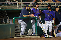 Fort Myers Mighty Mussels coach Derek Shomon (47), Aaron Sabato (27), and Jeferson Morales (5) during a game against the St. Lucie Mets on June 3, 2021 at Hammond Stadium in Fort Myers, Florida.  (Mike Janes/Four Seam Images)