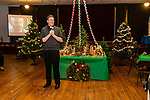 WATERBURY, CT. 21 December 2019-122119BS296 - Father James Sullivan greets all who have filled the basement, for a Christmas Party for the less fortunate and homeless at the Basilica of Immaculate Conception in Waterbury on Saturday. Bill Shettle Republican-American