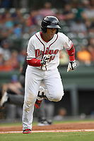 Catcher Roldani Baldwin (16) of the Greenville Drive runs out a batted ball in a game against the Asheville Tourists on Wednesday, August 2, 2017, at Fluor Field at the West End in Greenville, South Carolina. Greenville won, 1-0. (Tom Priddy/Four Seam Images)