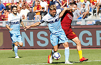 Lazio's Ciro Immobile, center, is challenged by Roma's Kostas Manolas during the Italian Serie A football match between Roma and Lazio at Rome's Olympic stadium, September 29, 2018. Roma won 3-1.<br /> UPDATE IMAGES PRESS/Riccardo De Luca