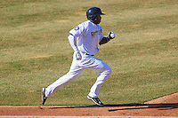 Wisconsin Timber Rattlers outfielder Monte Harrison (3) sprints to first base during a game against the Peoria Chiefs on April 12th, 2015 at Fox Cities Stadium in Appleton, Wisconsin.  Peoria defeated Wisconsin 11-1.  (Brad Krause/Four Seam Images)