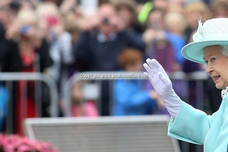 Britain's Queen Elizabeth II wave to the local people of Coleraine, as they finish their three day tour of Northern Ireland, Wednesday June 25, 2014. Photo/Paul McErlane