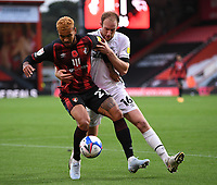 31st October 2020; Vitality Stadium, Bournemouth, Dorset, England; English Football League Championship Football, Bournemouth Athletic versus Derby County; Matthew Clarke of Derby County competes for the ball with Joshua King of Bournemouth