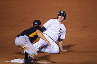 Tampa Yankees designated hitter Austin Aune (21) slides into third as Connor Joe (6) applies the tag during a game against the Bradenton Marauders on April 11, 2016 at George M. Steinbrenner Field in Tampa, Florida.  Tampa defeated Bradenton 5-2.  (Mike Janes/Four Seam Images)