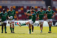 24th April 2021; Brentford Community Stadium, London, England; Gallagher Premiership Rugby, London Irish versus Harlequins; Paddy Jackson of London Irish kicks the ball to the line